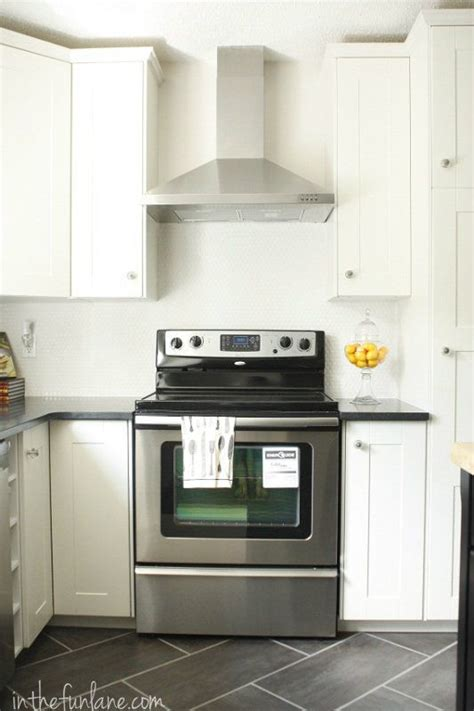kitchen renovations using gray and white grey floor black granite counters white cabinets
