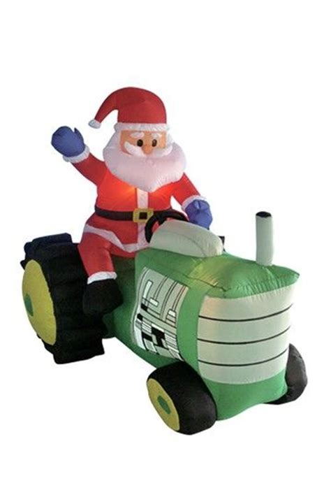 large blow up christmas decorations outdoor airblown decorations santa claus driving tractor up yard