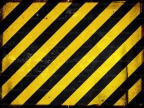 Black and Yellow Hazard Stripes Wallpaper