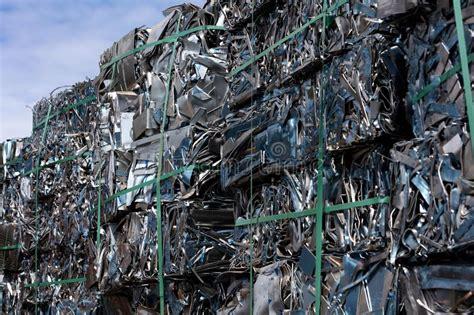 scrap metal cubes stock photo image  garbage excess