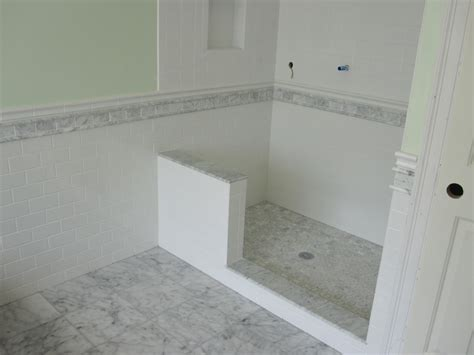 marble and subway tile master bathroom
