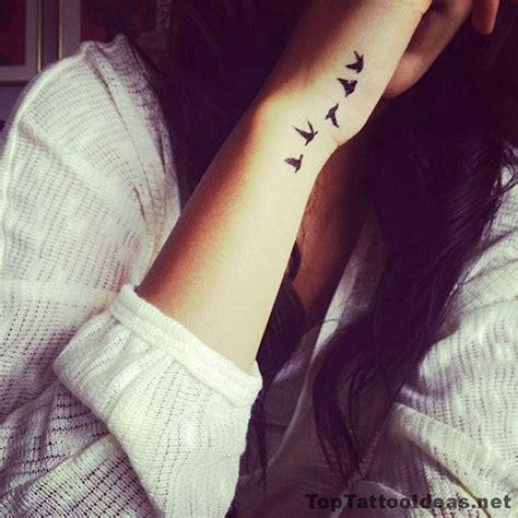 tiny tattoo idea birds leaving  wrist tattoo idea top tattoo ideas  small tattoos