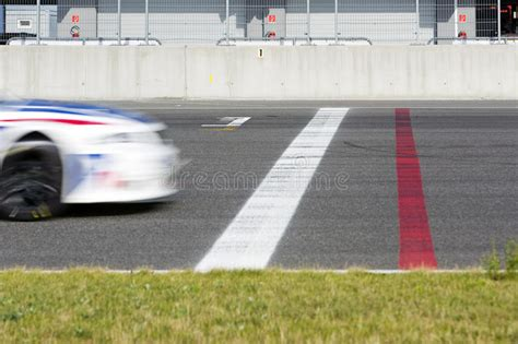 Race Car Crossing The Finish Line Stock Photo