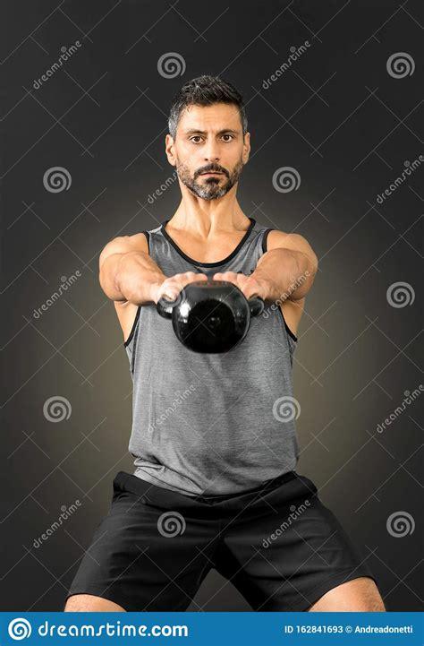 kettlebell raising extending weight