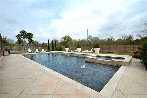 huge backyard  sparkling pool spa wstamped concrete
