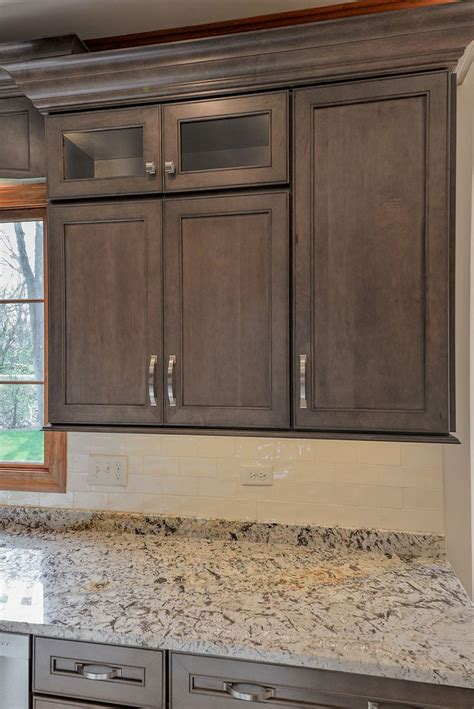painting over stained cabinets stain over paint kitchen cabinets everdayentropy com