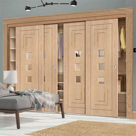 bespoke thruslide altino oak glazed  door wardrobe
