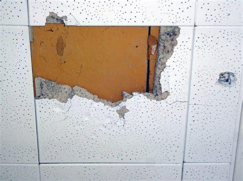 damaged asbestos ceiling tile damaged  ft square