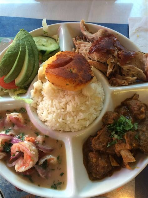 cuisine company bandera quot ecuadorian dish with roasted pork goat stew