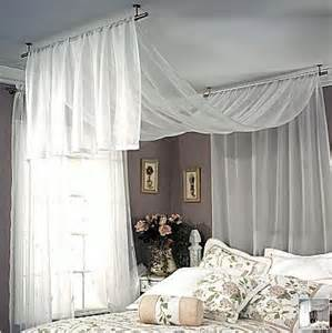 sheer fabric draped over the bed for the home