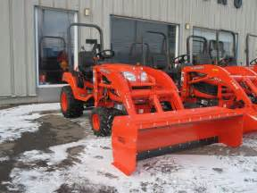 Compact Tractor with Snow Plow