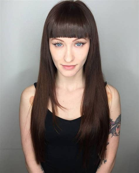 straight long hairstyles with bangs pin on hair