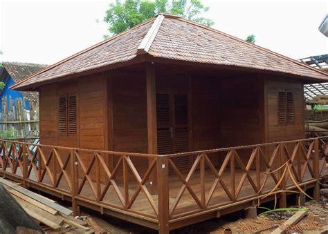 contoh desain rumah minimalis  bahan kayu terbaru