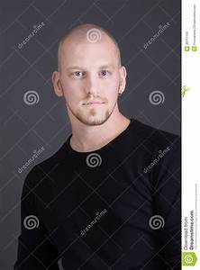 Portrait Of A Cool Young Man Isolated On Black Stock Photo