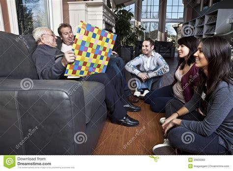 Senior Man Story Telling To His Family Stock Photo  Image 20606060