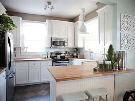 White Cabinets And Butcher Block Countertops In A Small