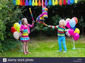 Kids birthday party. Group of children hitting pinata and ...