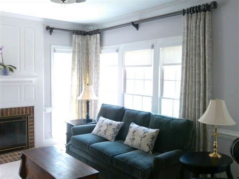 corner drapery plus dramatic hardware window treatments