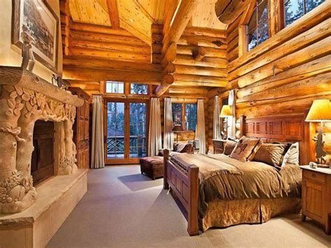 Amazing Log Home Bedroom! That Fireplace Is Incredible.