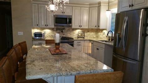 savannah hazlenut glaze cabinets travertine tile