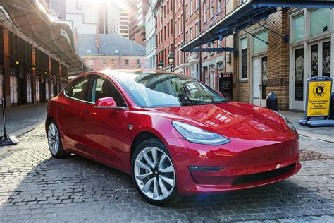 teslas model  pricing inches closer   target