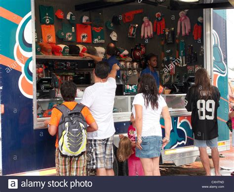miami dolphins fan gear miami dolphins fans at a merchandise store trailer at sun