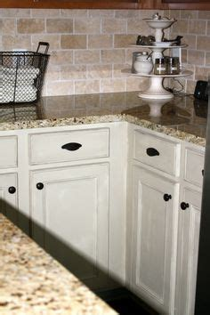 brown and green kitchen cabinets with back splashes brown countertop 4933
