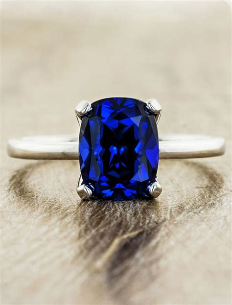 Heather Modern Cushion Cut Blue Sapphire Engagement Ring. Embossed Wedding Rings. Pair Gold Engagement Rings. Celebrity Jewelry Rings. 2.5 Year Wedding Rings. Hipster Wedding Wedding Rings. Wills Engagement Rings. Luxurious Wedding Rings. Many Diamond Engagement Rings