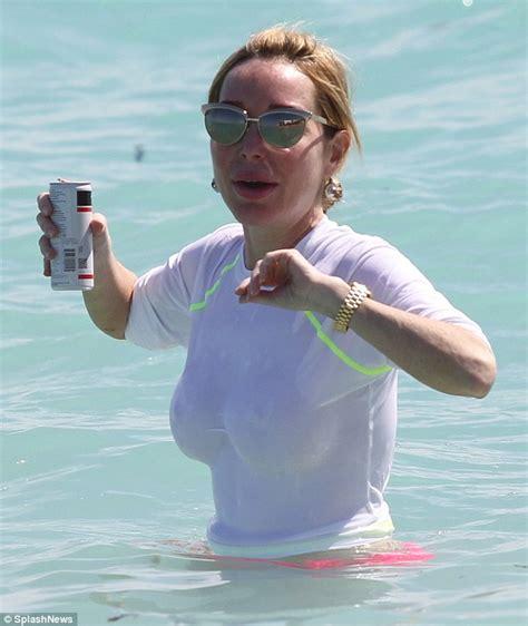 Marysol Patton hits Miami Beach braless in a see-through ...