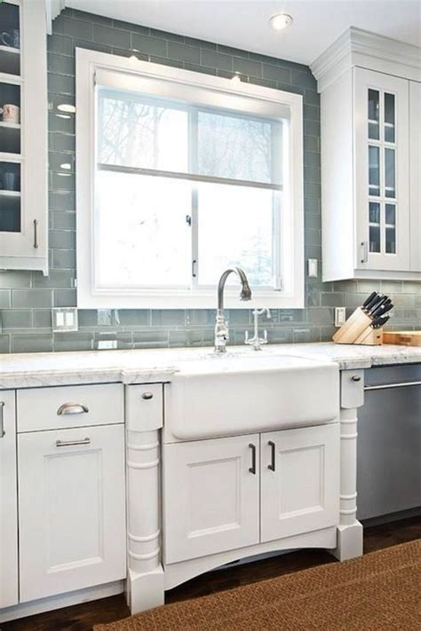 chagne glass subway tile grey glass subway tile kitchen backsplash with a farmhouse sink but change the cabinets to