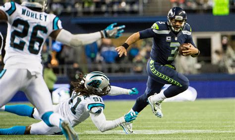 panthers drop    seed  loss seahawks win