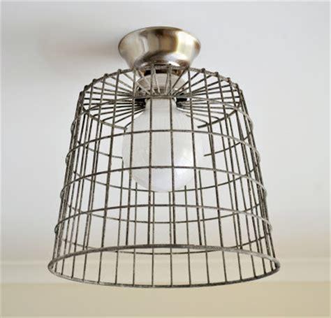 diy repurposed basket ceiling light  painted hive