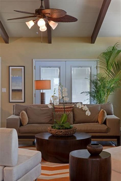 tropical living room design  brown couch  palm tree
