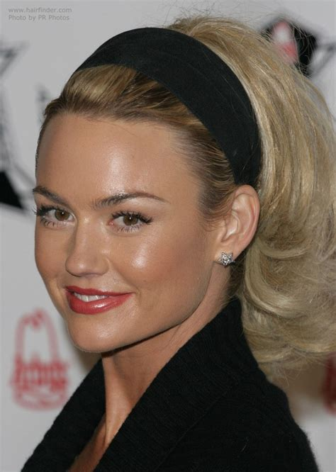 kelly carlson   hair puffed   wearing  headband