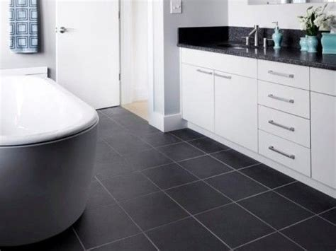 white cabinets with black tile floor kitchen dining