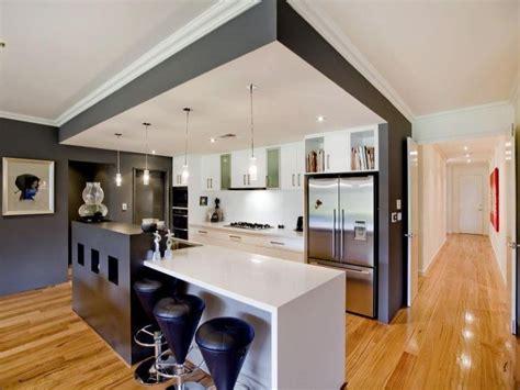 Chandelier Over Bathroom Sink by Modern Island Kitchen Design Using Frosted Glass Kitchen
