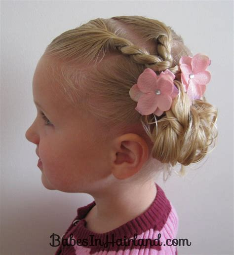 It looks like her hair is fashioned into a sideways french braid, up high on her head, and then brought back around to create the basket handle. 5 Pretty Easter Hairstyles - Babes In Hairland