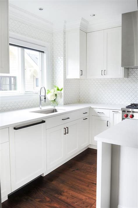 all white kitchen tiles that go up to the ceiling