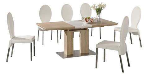 extending dining table and 6 white chairs wood finish