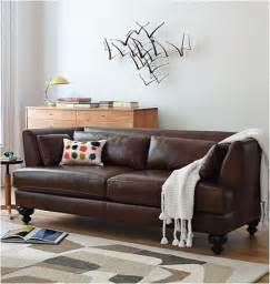 brown sofas completing design of living room with wooden