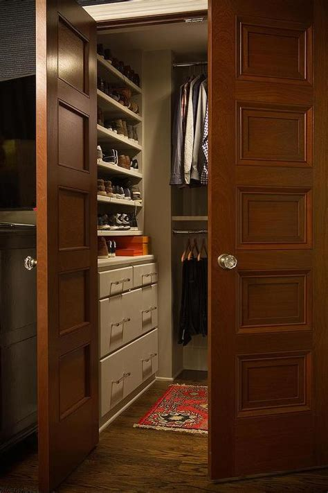 closet  paneled double doors traditional closet