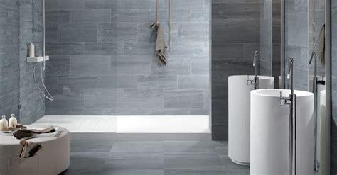 give  sophisticated   grey bathroom tiles bath