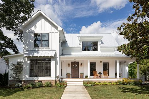 white farmhouse exterior front porch homes exterior traditional with standing seam roof gray decorative jars and urns