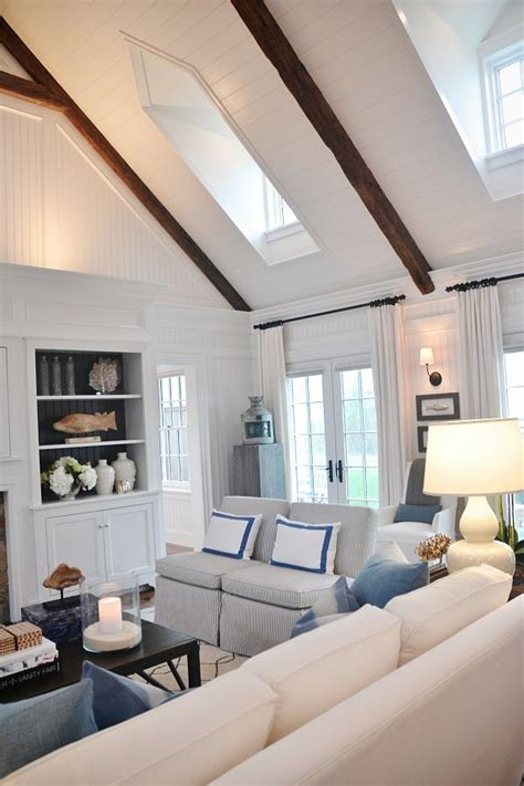 ideas  nautical living rooms  pinterest coastal inspired printed art navy  white rug  white sofa inspiration