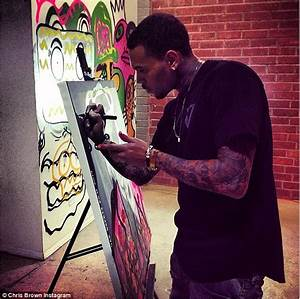 Chris Brown shows off his artwork at Andy Warhol art ...
