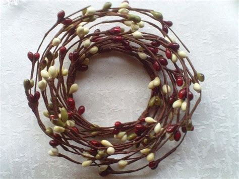 candle ring snow red berries 25 unique candle rings ideas on diy candle arrangements diy flower centerpieces