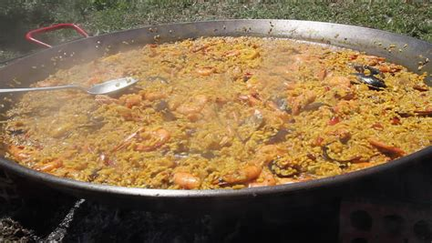 cooking paella outdoors releasing steam  cook paella
