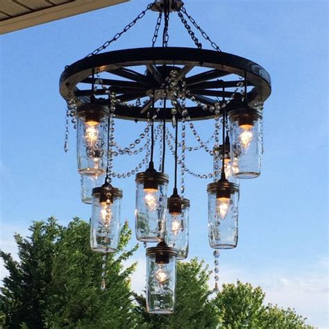 best 25 wheel chandelier ideas on wagon wheel