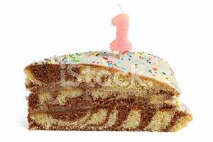 Slice of Birthday Cake With Number One Candle stock photos ...