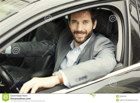 Portrait Of Man In His Car Looking Camera Stock Image